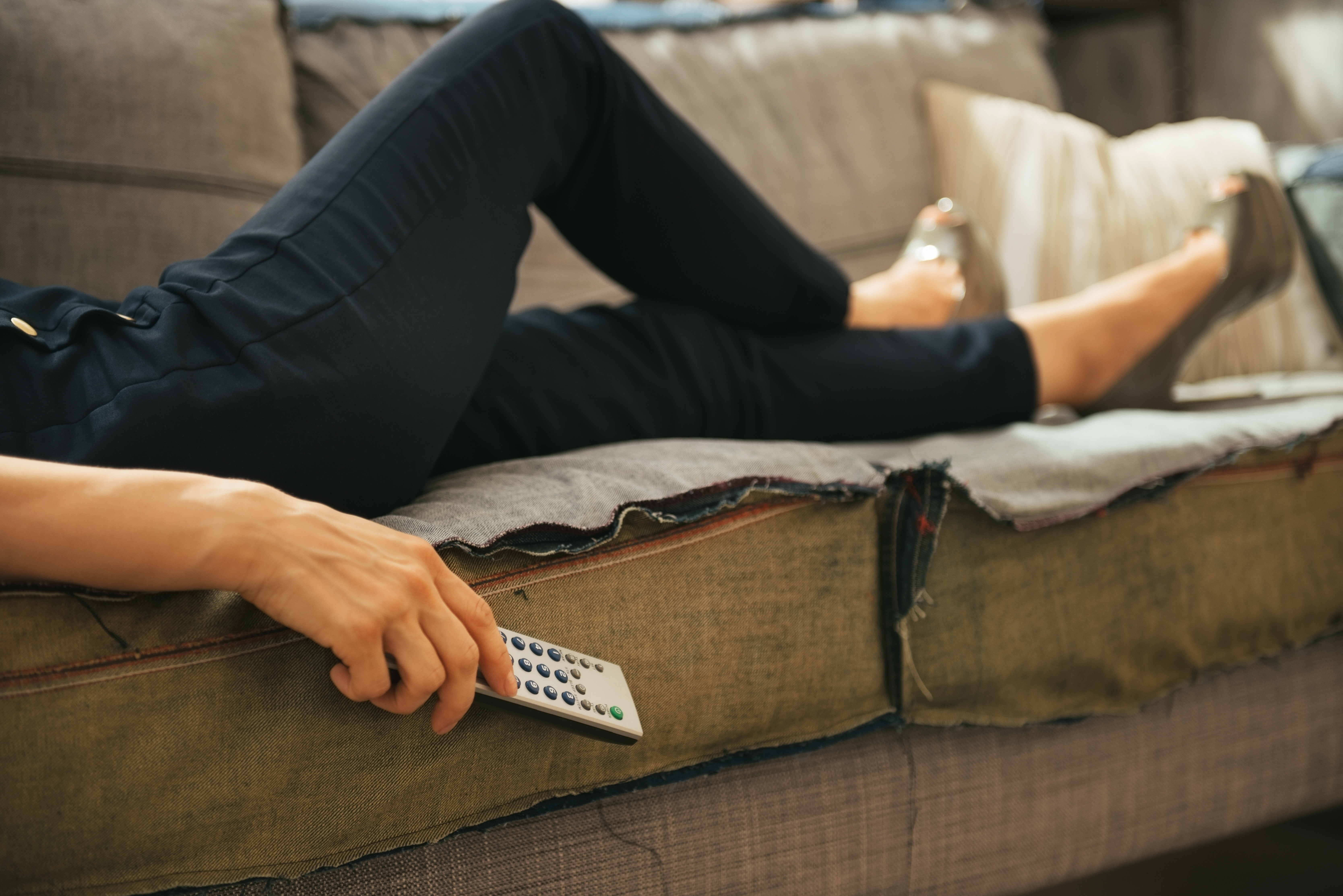 Closeup on young woman watching tv in loft apartment